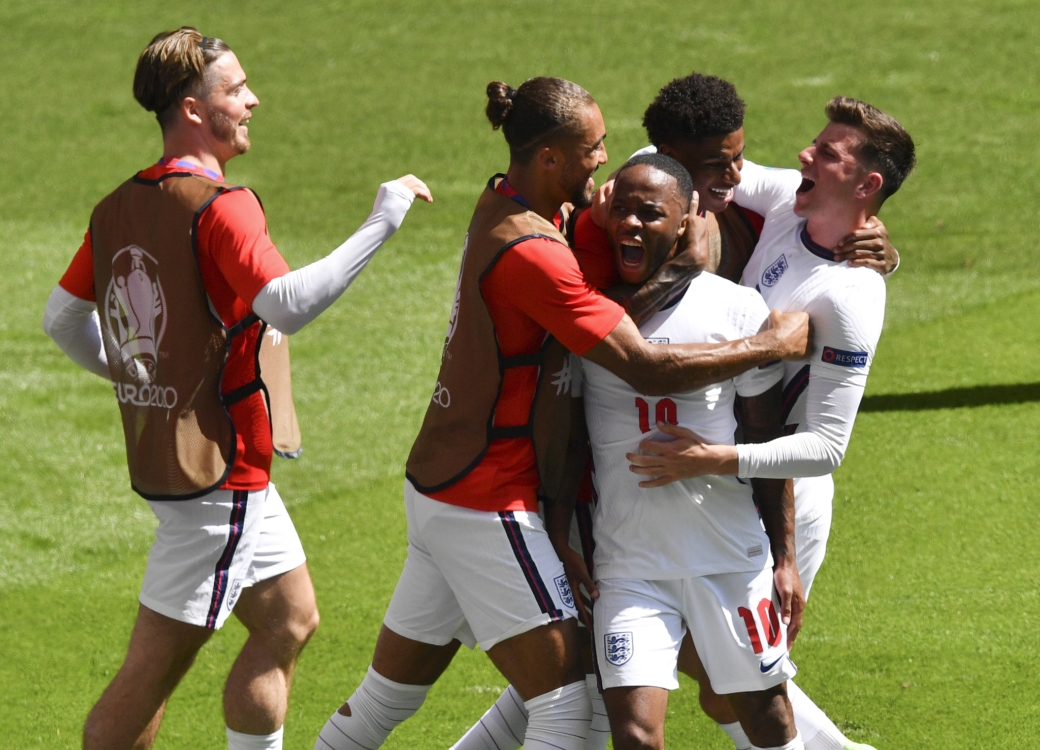 England's Raheem Sterling is congratulated by teammates