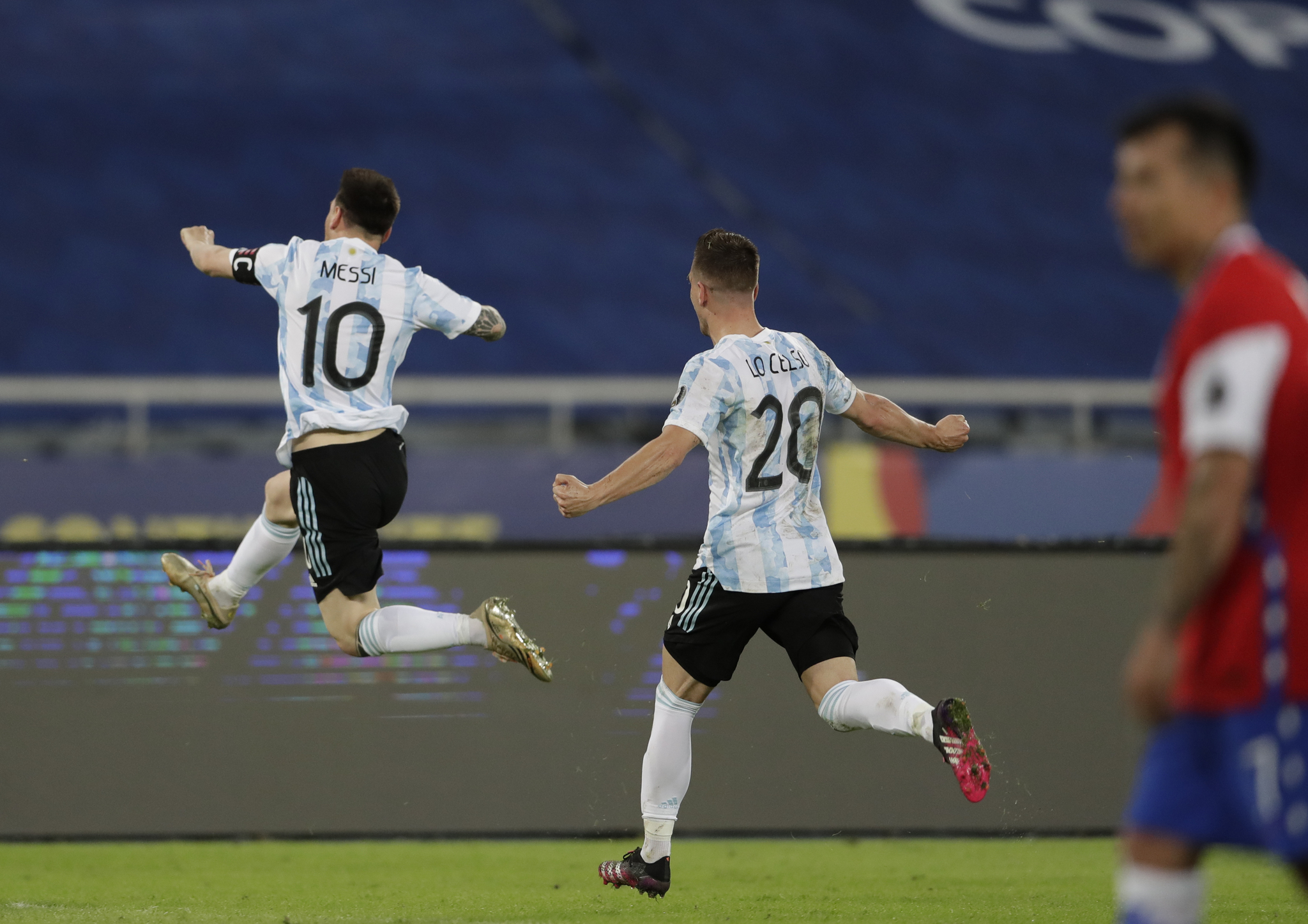 Lionel Messi celebrates scoring his side's opening goal against Chile