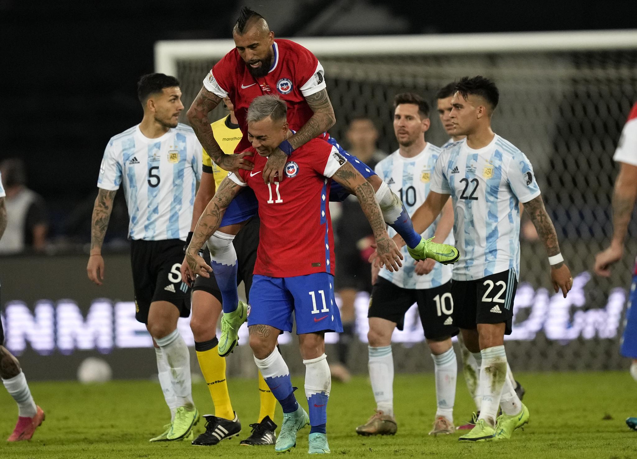 Chile's Eduardo Vargascelebrates scoring against Argentina