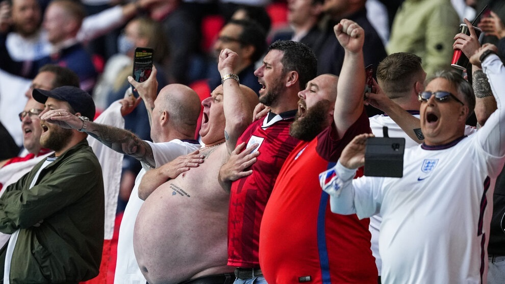England supporters cheer prior the Euro 2020 soccer championship group D match between Czech Republic and England at Wembley stadium in London.