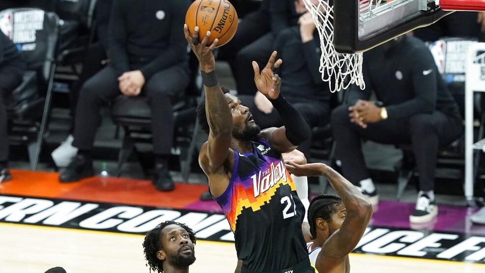 Phoenix Suns center Deandre Ayton, middle, shoots against the Los Angeles Clippers.