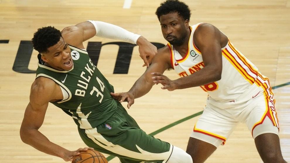 Milwaukee Bucks' Giannis Antetokounmpo is fouled by Atlanta Hawks' Solomon Hill.