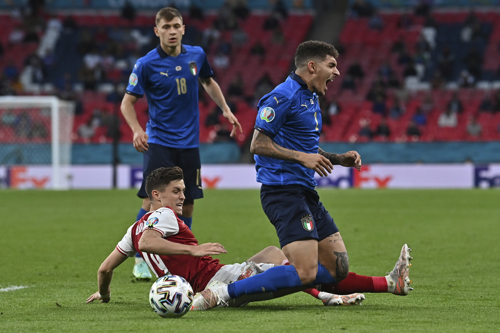 Giovanni Di Lorenzo is challenged by Austria's Christoph Baumgartner