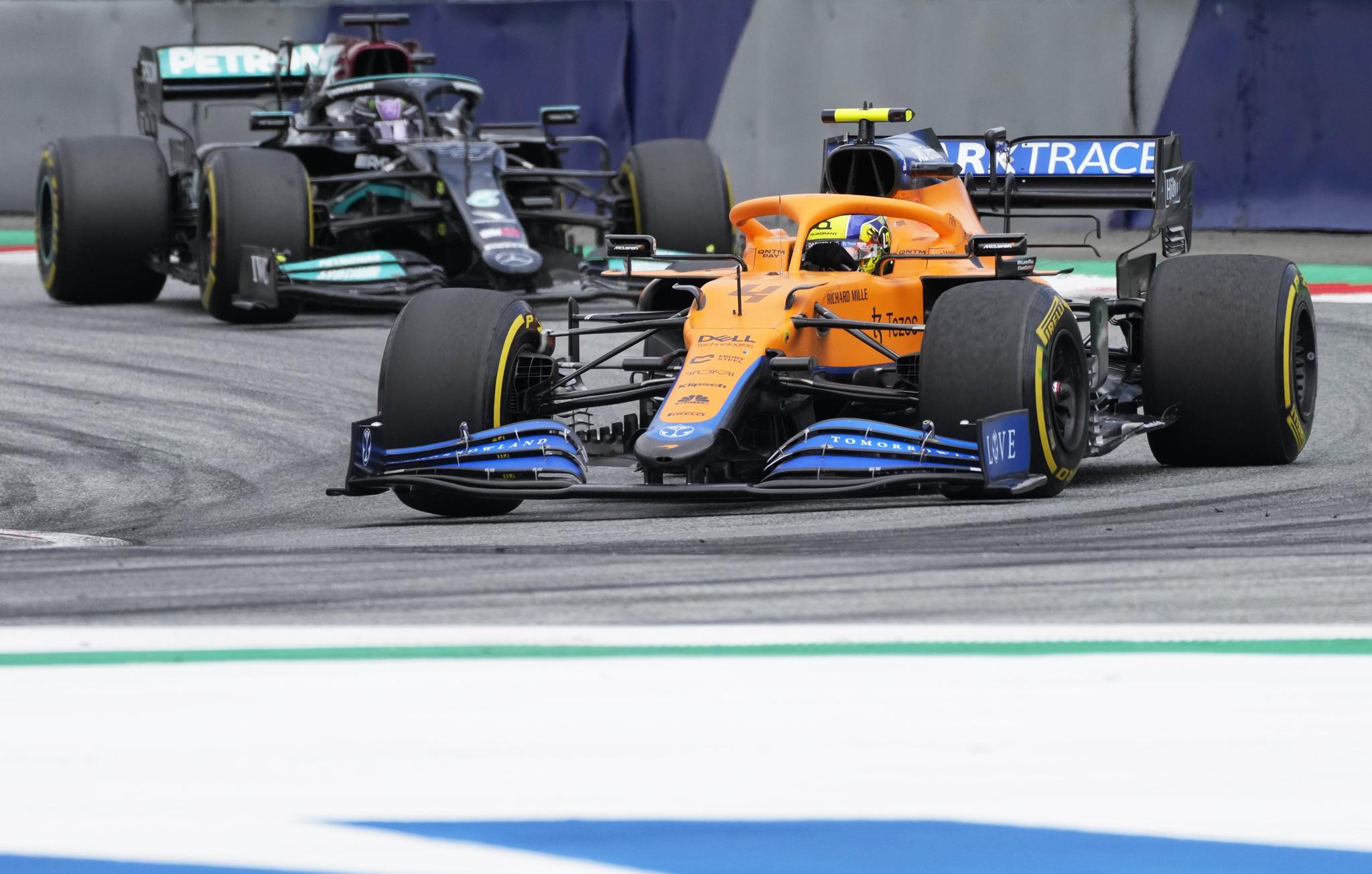 Mclaren driver Lando Norris followed by Mercedes driver Lewis Hamilton