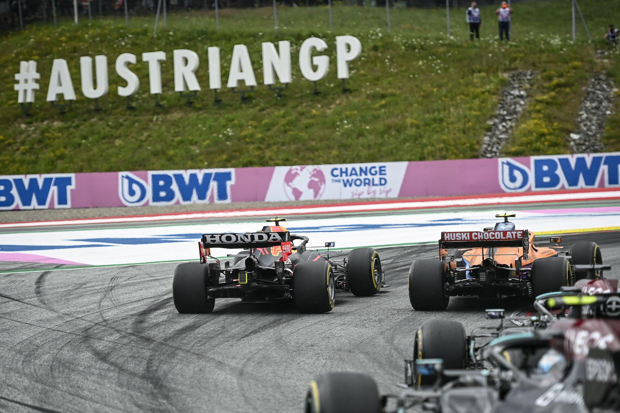 Sergio Perez tries to overtake Lando Norris