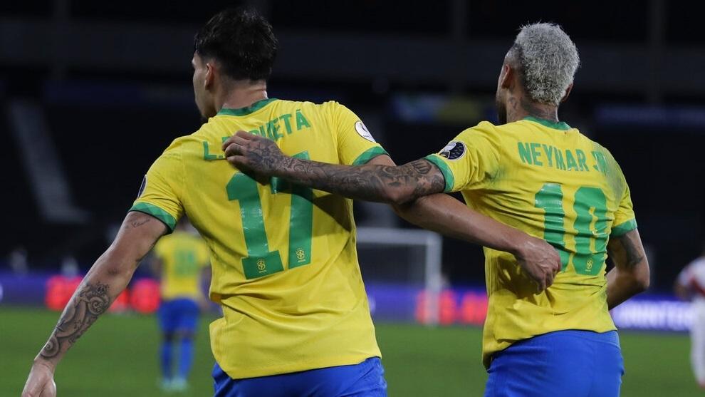 Brazil's Lucas Paqueta, left, celebrates with teammate Neymar after scoring.