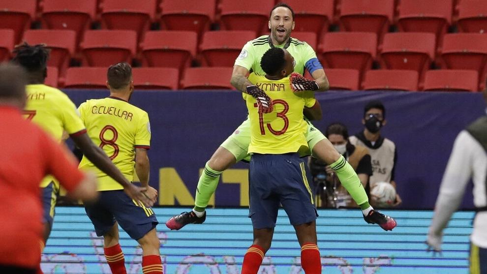 Colombia's goalkeeper David Ospina celebrates with teammate Yerry Mina (13).