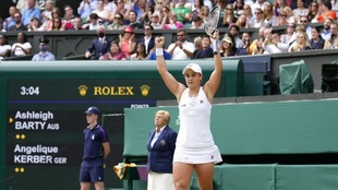 Australia's Ashleigh Barty celebrates after defeating...