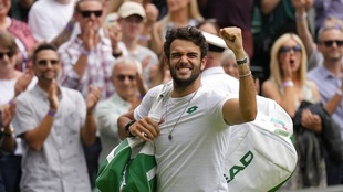 Italy's Matteo Berrettini celebrates after defeating...