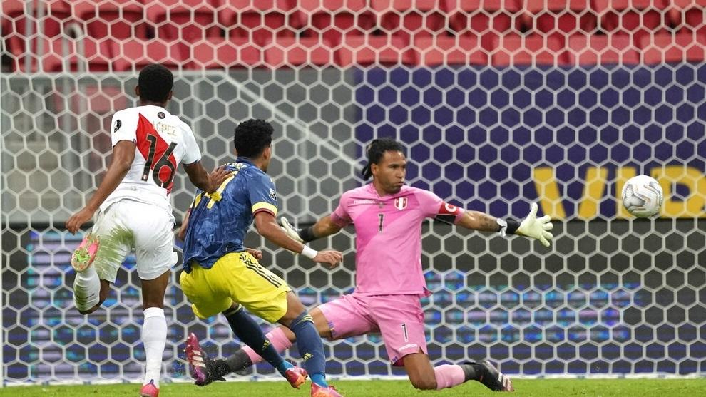 Colombia's Luis Diaz, center, scores his side's second goal against Peru.