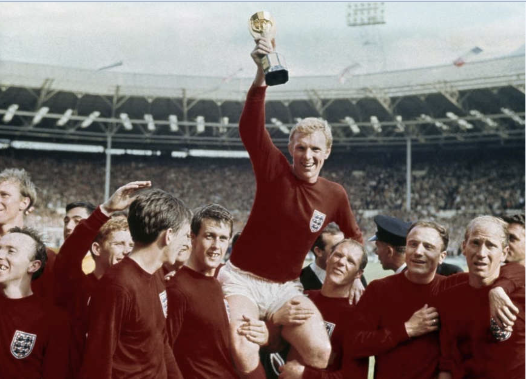 Bobby Moore and his England teammates celebrate winning the 1966 World Cup.
