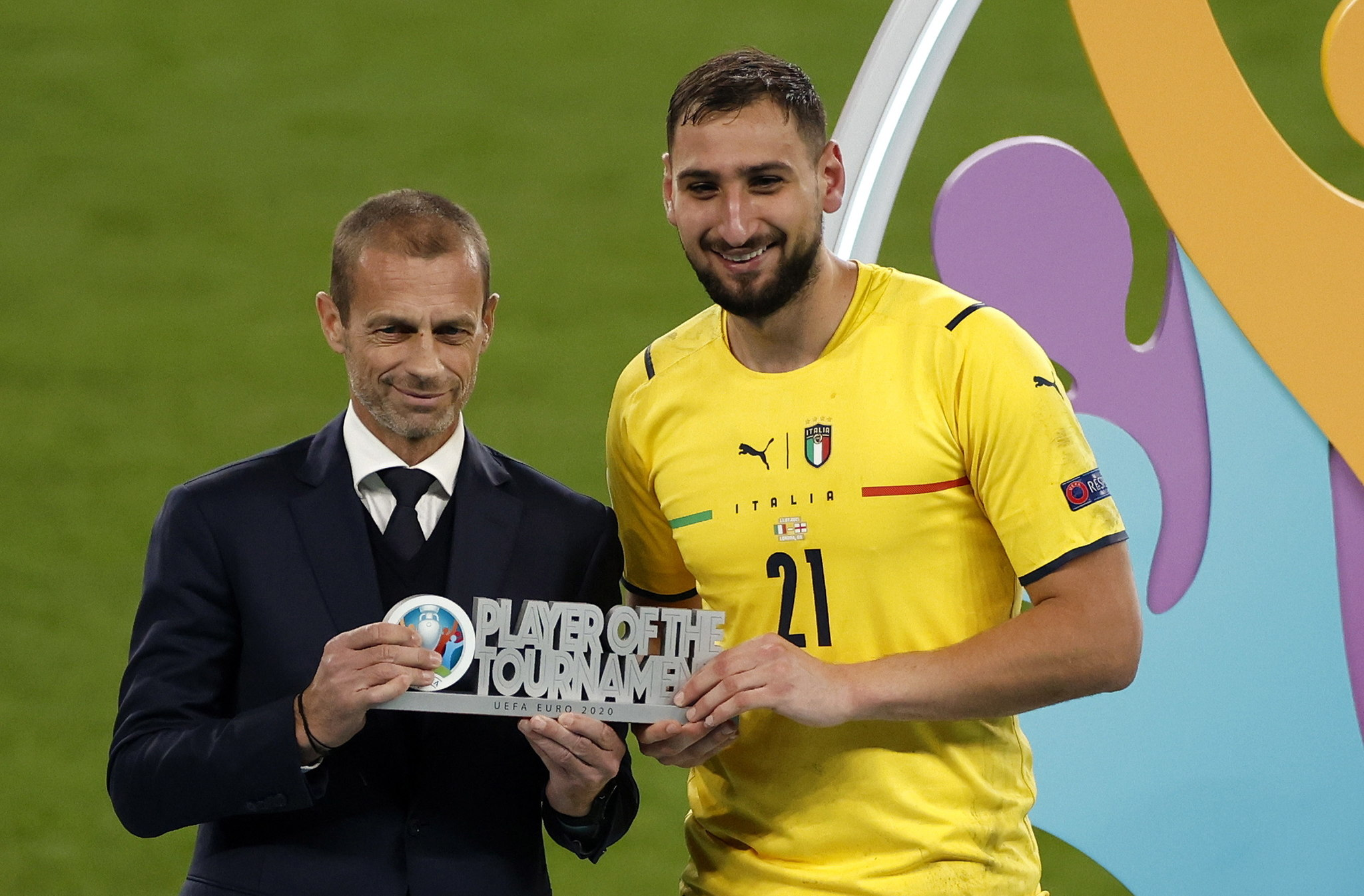 Gianluigi Donnarumma receives the Player of the Tournament award
