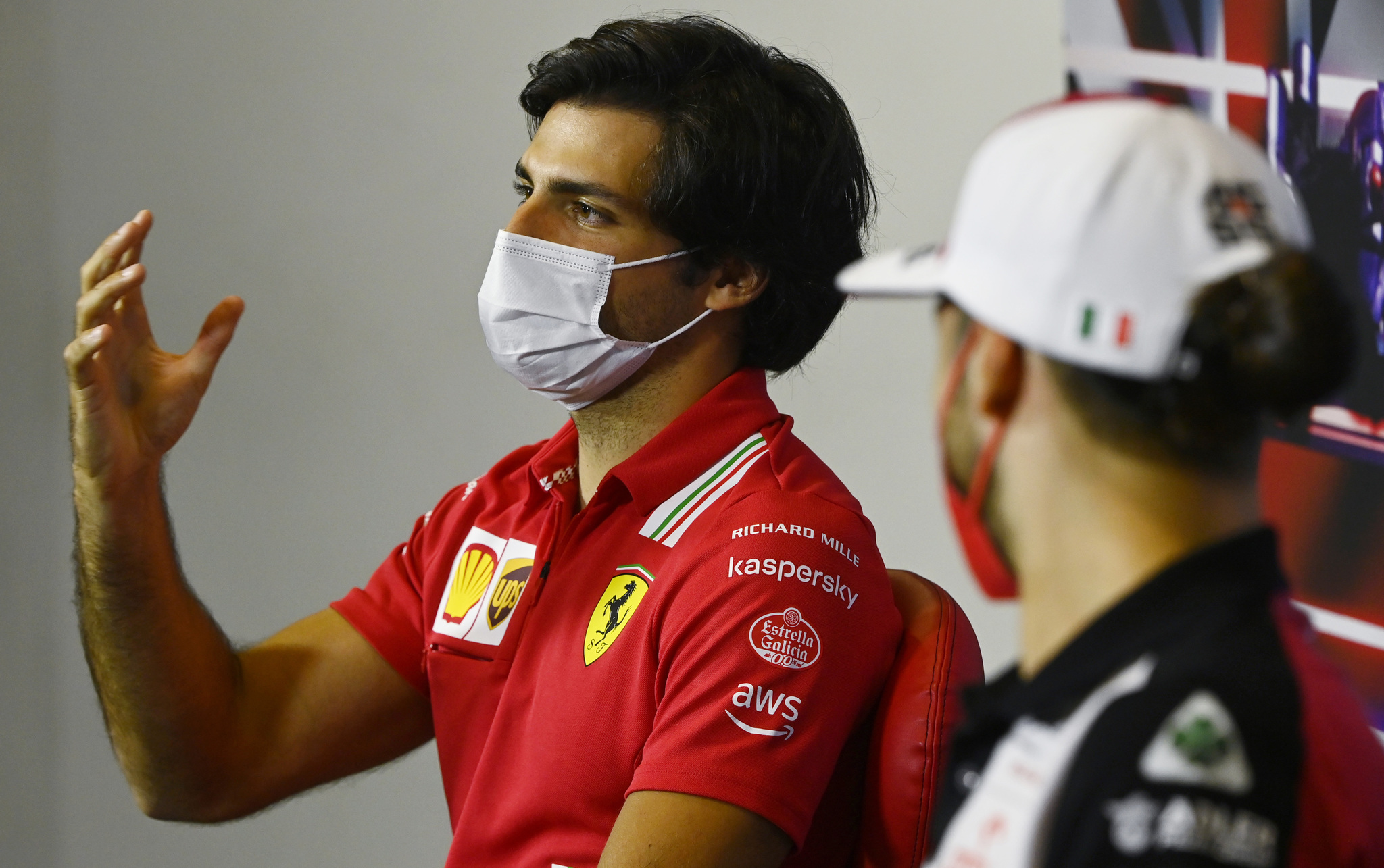 Ferrari driver Carlos Sainz of Spain, left, and Alfa Romeo driver Antonio Giovinazzi of Italy attend a media conference at the lt;HIT gt;Silverstone lt;/HIT gt; circuit, lt;HIT gt;Silverstone lt;/HIT gt;, England, Thursday, July 15, 2021. The British Formula One Grand Prix will be held on Sunday. (Mark Sutton, Pool Photo via AP)