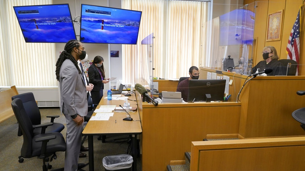 NFL football player Richard Sherman stands during a hearing at King County District Court.