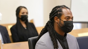 NFL football player Richard Sherman sits in King County District Court...