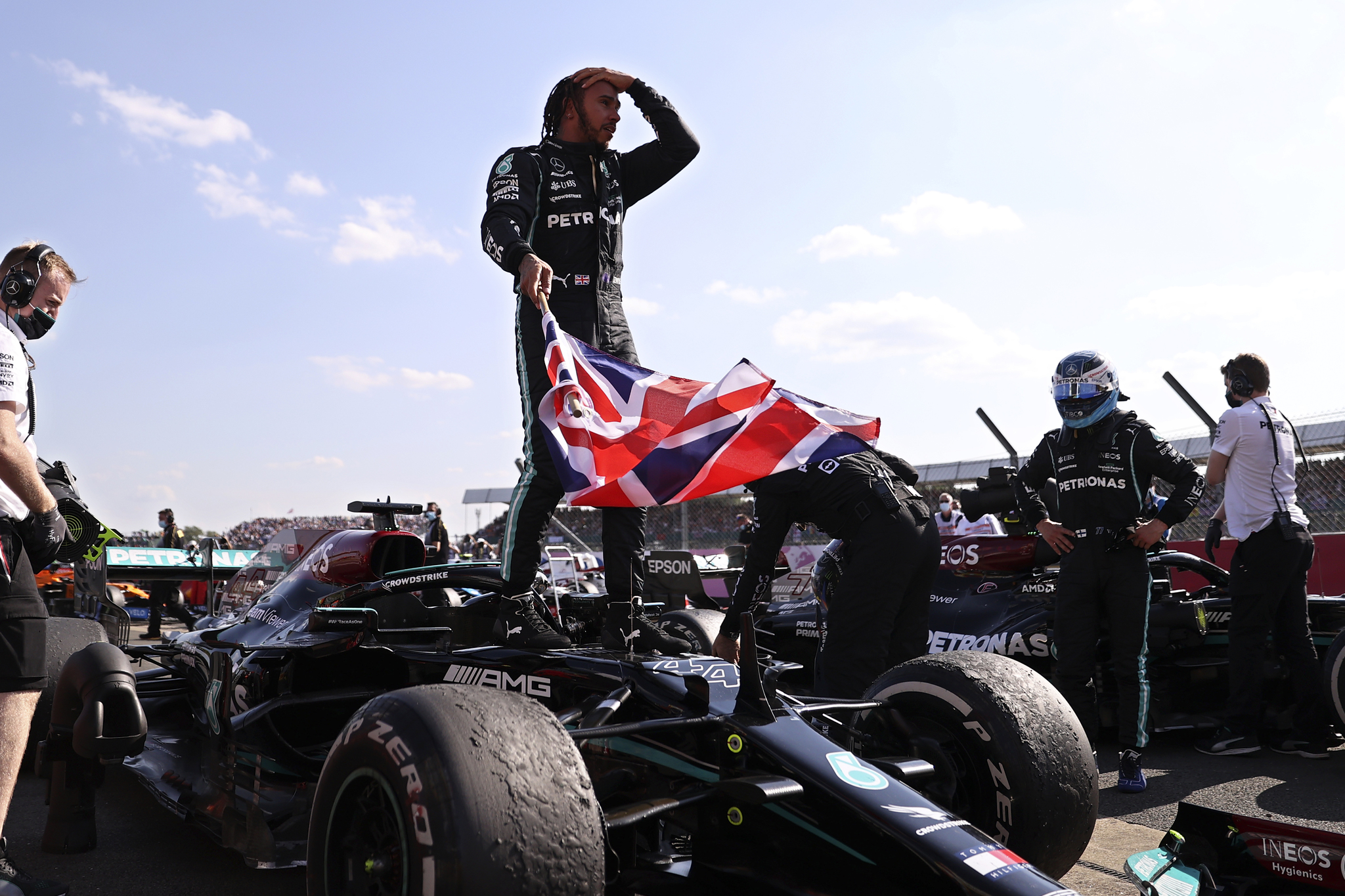 Mercedes driver Lewis lt;HIT gt;Hamilton lt;/HIT gt; of Britain celebrates after winning the British Formula One Grand Prix, at the Silverstone circuit, in Silverstone, England, Sunday, July 18, 2021. (Lars Baron/Pool photo via AP)