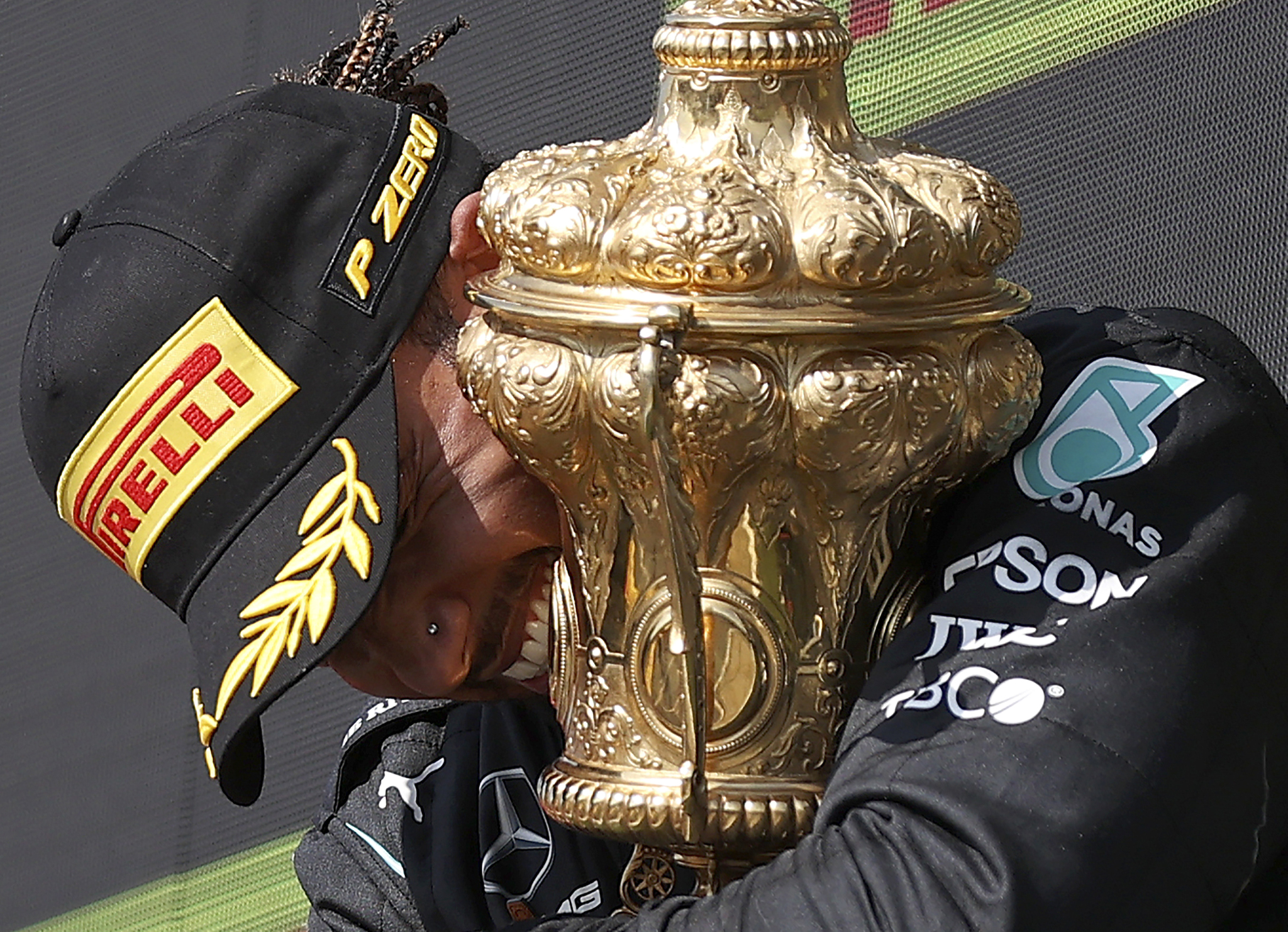 Mercedes driver Lewis lt;HIT gt;Hamilton lt;/HIT gt; of Britain celebrates on the podium after winning the British Formula One Grand Prix, at the Silverstone circuit, in Silverstone, England, Sunday, July 18, 2021. (Lars Baron/Pool photo via AP)