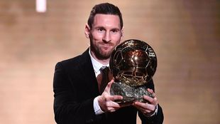 Messi with the Ballon d'Or award