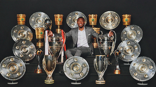 David Alaba poses with the titles he won in his 11 years with Bayern...