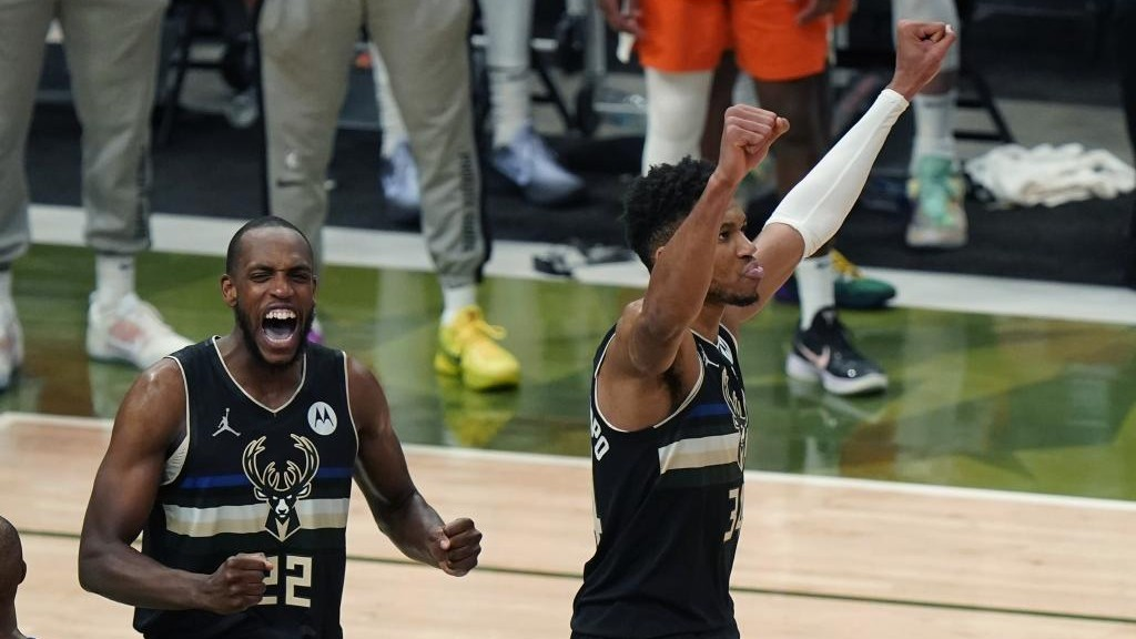 Giannis Antetokounmpo and Khris Middleton celebrate the win over the Suns.