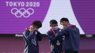 Taiwan's Deng Yu-Cheng, Tang Chih-Chun, and Wei Chun-Heng put on their...