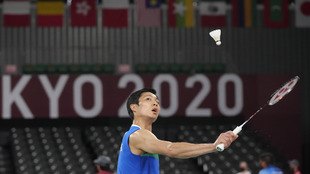 Tien-Chen Chou of Taiwan competes against Canada's Brian Yang...