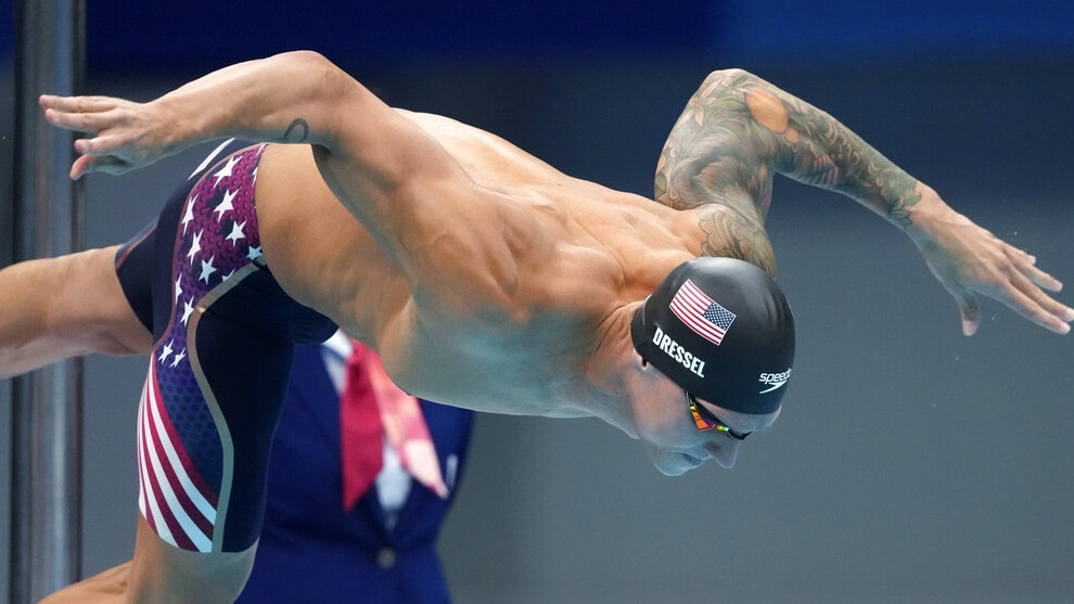 Caeleb Dressel of the United States starts in the men's 100-meter freestyle final.