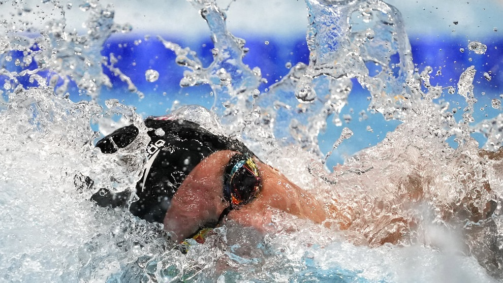 Caeleb Dressel of the United States swims in the men's 100-meter freestyle final.