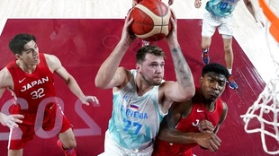 Slovenia's Luka Doncic drives to the basket against Japan's...