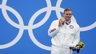 Dressel poses with the gold medal after winning the men's...