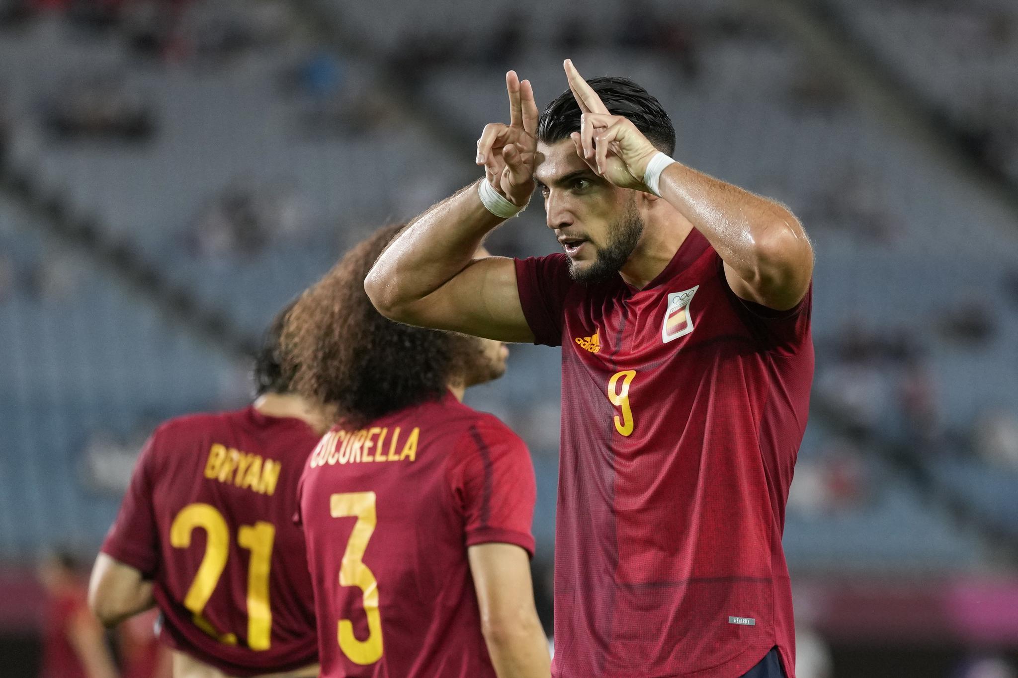 Spain striker Rafa Mir celebrates one of his goals against Ivory Coast.