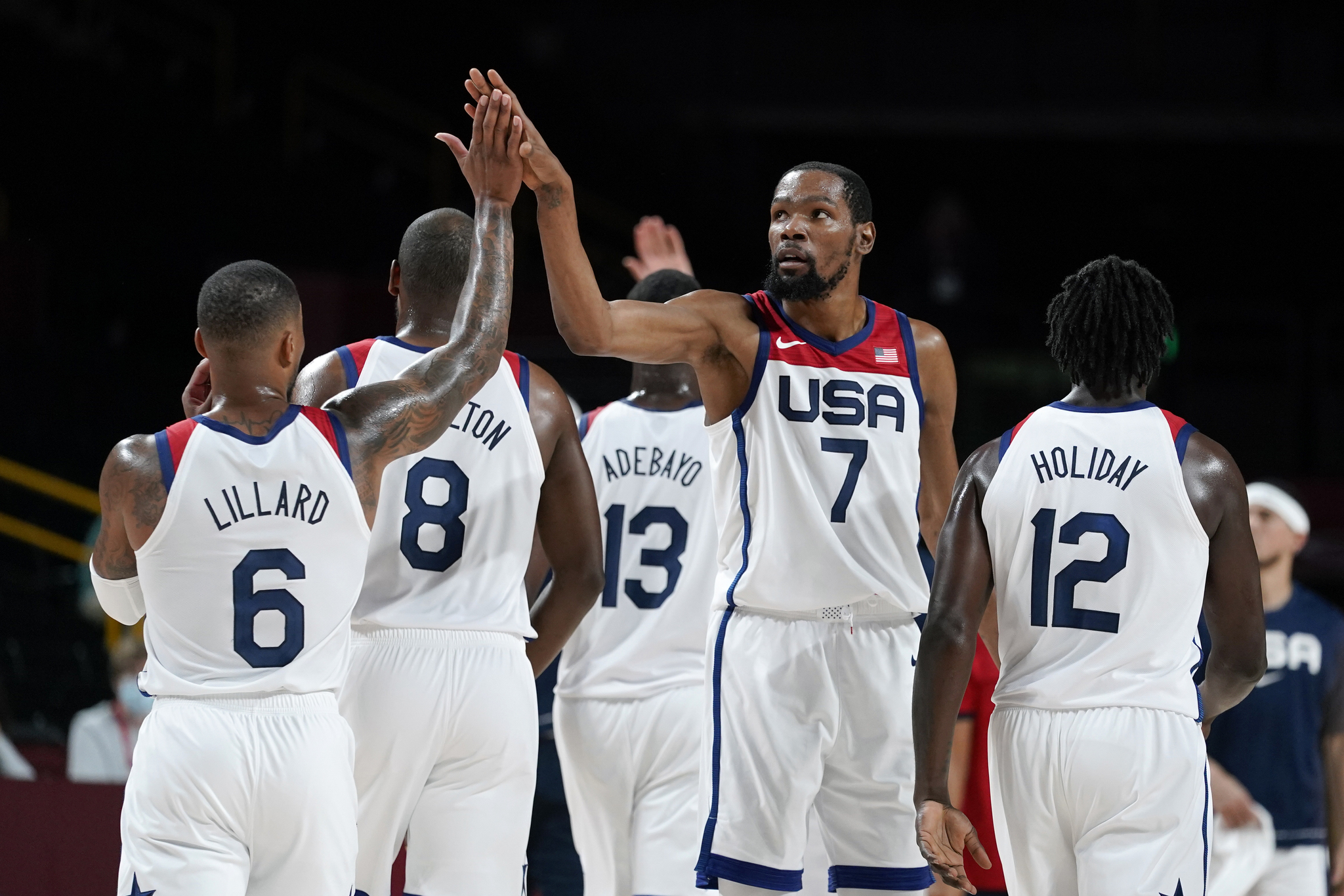 USA star Kevin Durant celebrates with teammate Damian Lillard during their match against the Czech Republic.