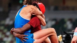 Barshim and Tamberi hug after the decision