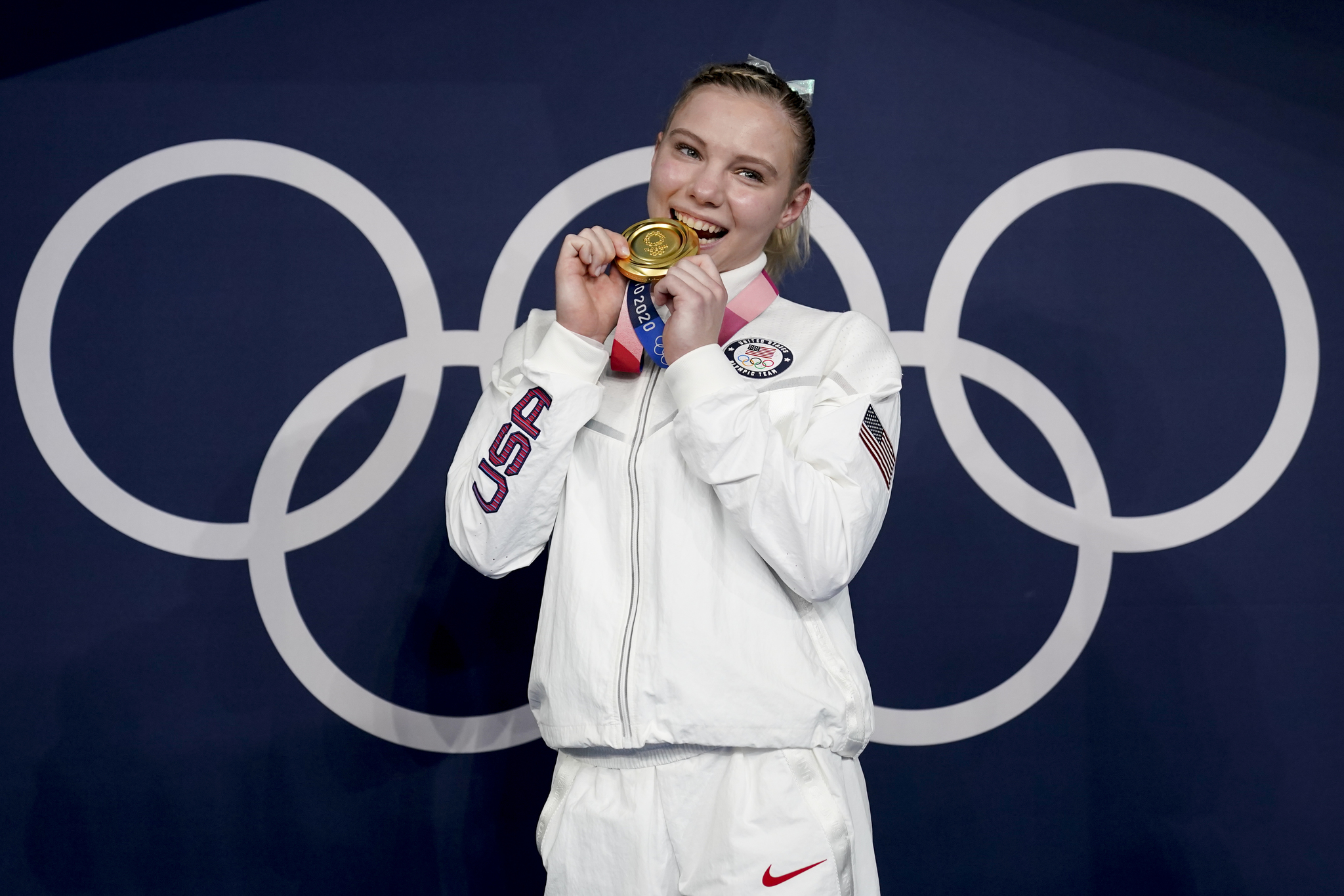 USA's Jade Carey poses after winning gold in the vault final.