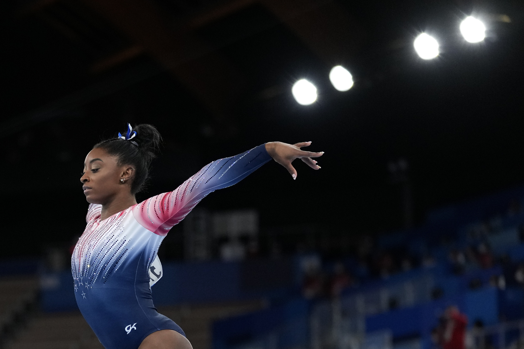 Simone lt;HIT gt;Biles lt;/HIT gt;, of the United States, performs on the balance beam during the artistic gymnastics women's apparatus final at the 2020 Summer Olympics, Tuesday, Aug. 3, 2021, in Tokyo, Japan. (AP Photo/Ashley Landis)