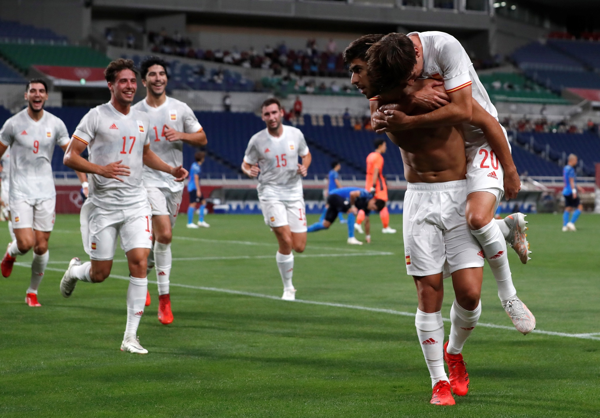 Spain's Marco Asensio celebrates with his teammates after scoring against Japan.