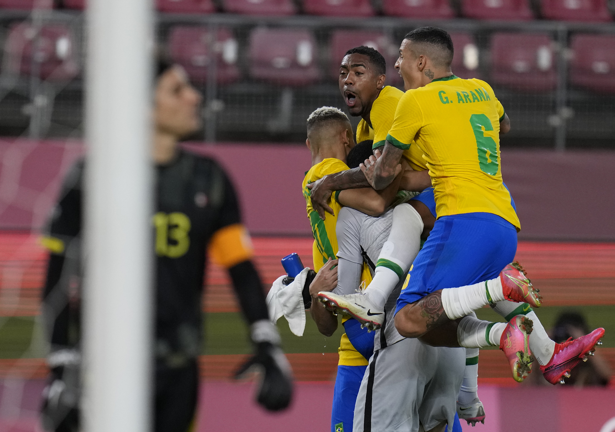 Brazil's players celebrate after beating Mexico on penalties in the semi-finals at Tokyo 2020.