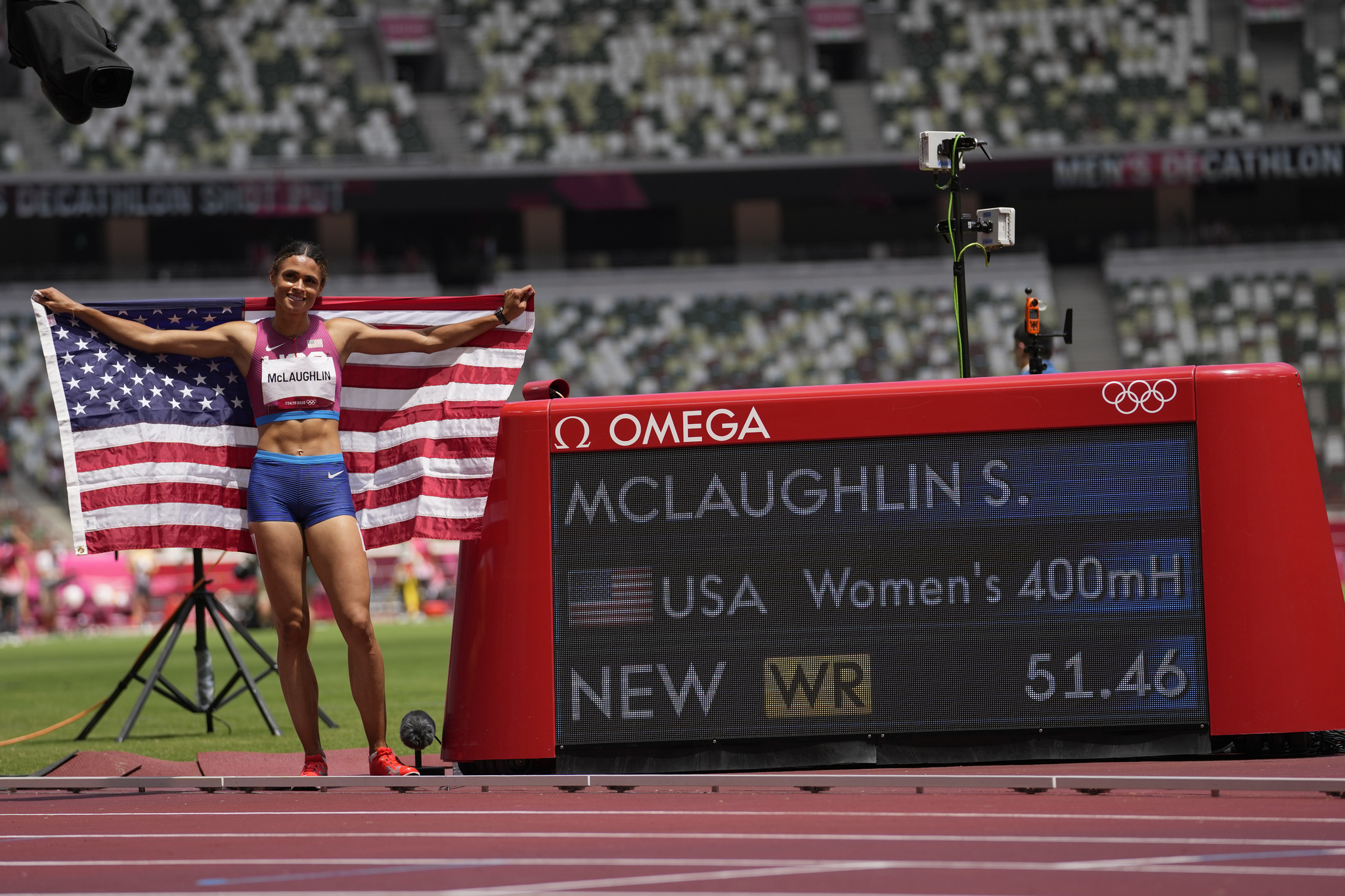 The USA's Sydney McLaughlin celebrates her world-record time in the women's 400m hurdles.