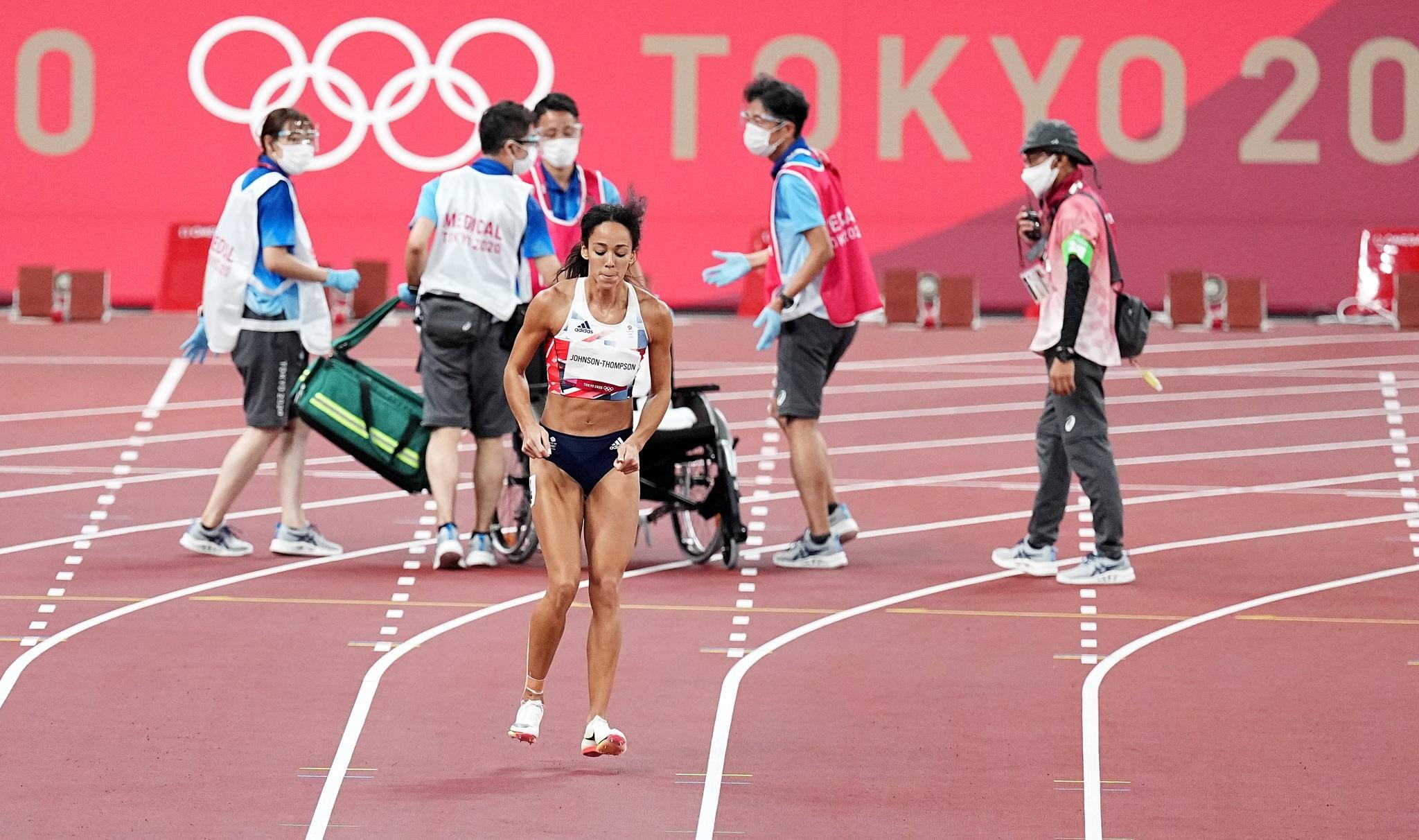 Great Britain's Katarina Johnson-Thompson limps towards the finish line.