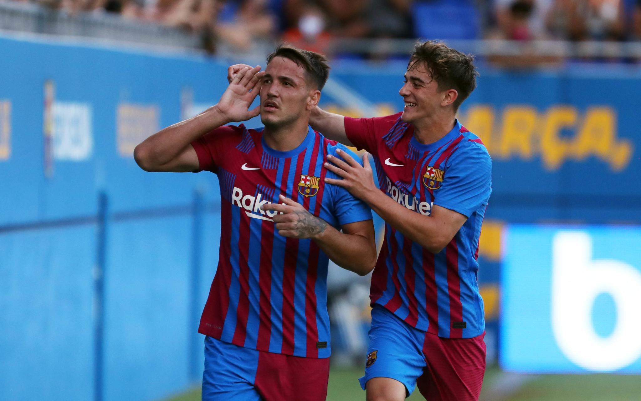 Rey Manaj celebrates scoring for Barcelona against Nastic de Tarragona.