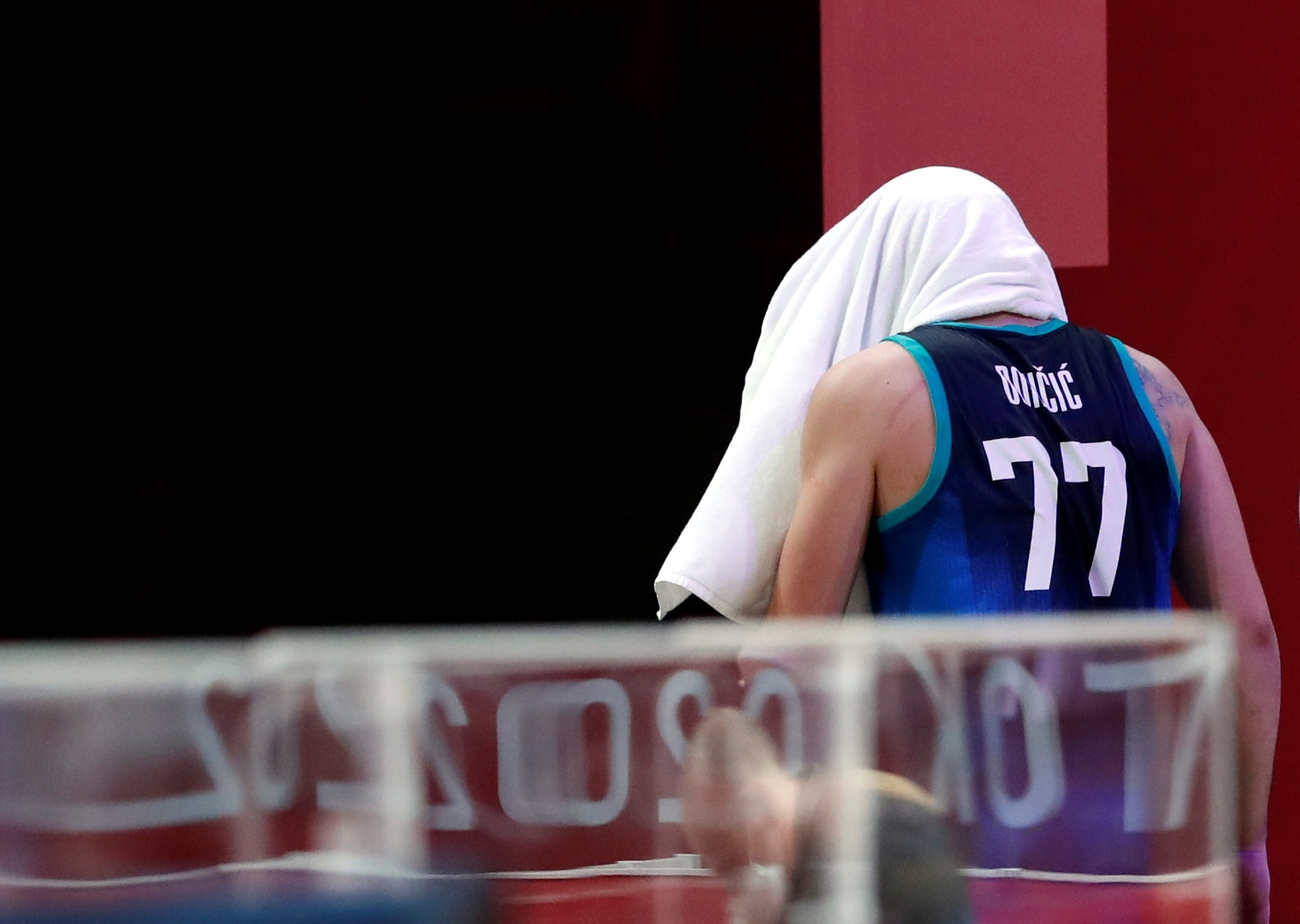 Slovenia star Luka Doncic leaves the arena after his team's loss against France.