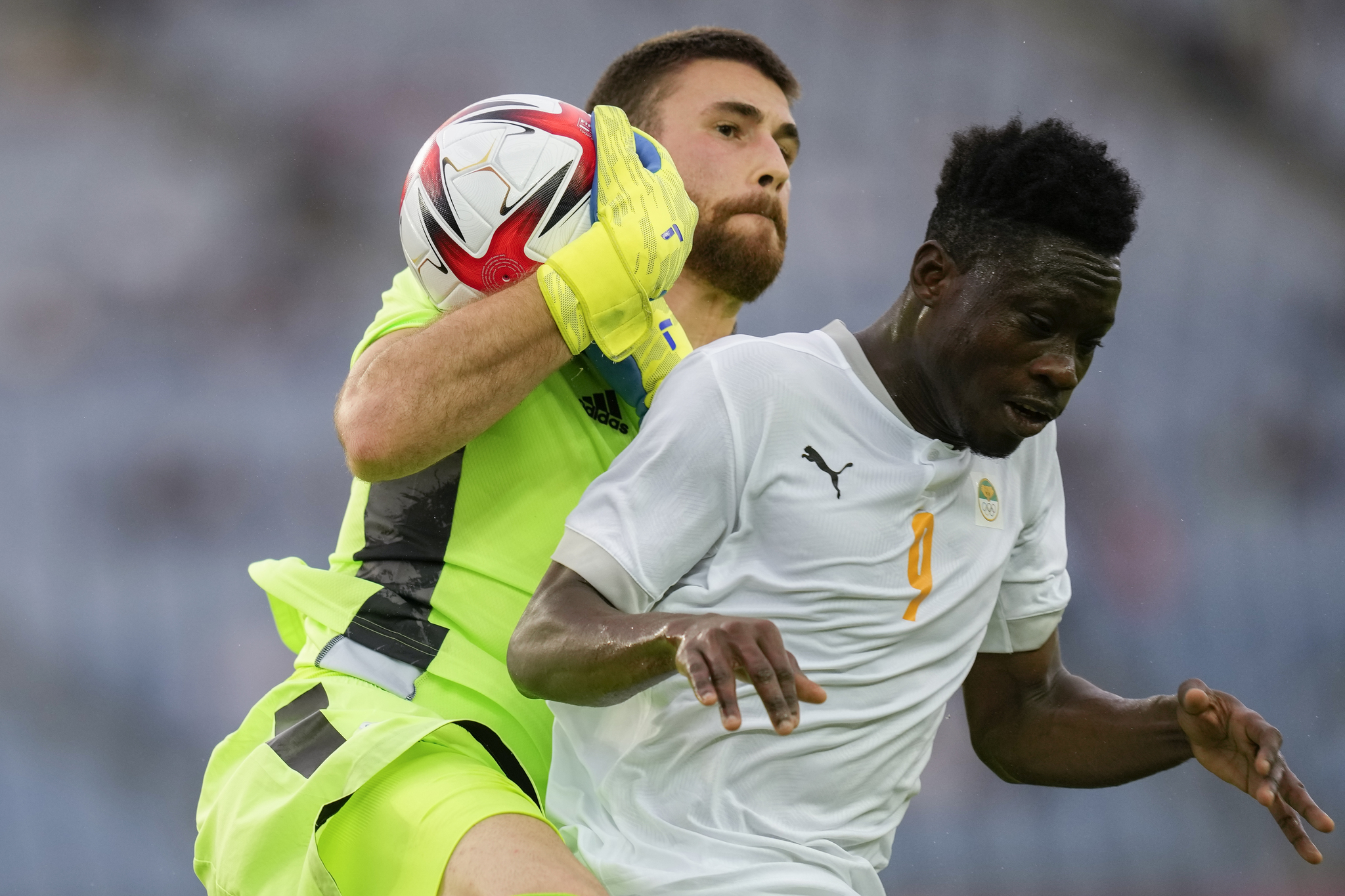 Spain's goalkeeper lt;HIT gt;Unai lt;/HIT gt; lt;HIT gt;Simon lt;/HIT gt; intercepts a shot challenged by Ivory Coast's Youssouf Dao in a men's quarterfinal soccer match at the 2020 Summer Olympics, Saturday, July 31, 2021, in Rifu, Japan, Tokyo. (AP Photo/Andre Penner)