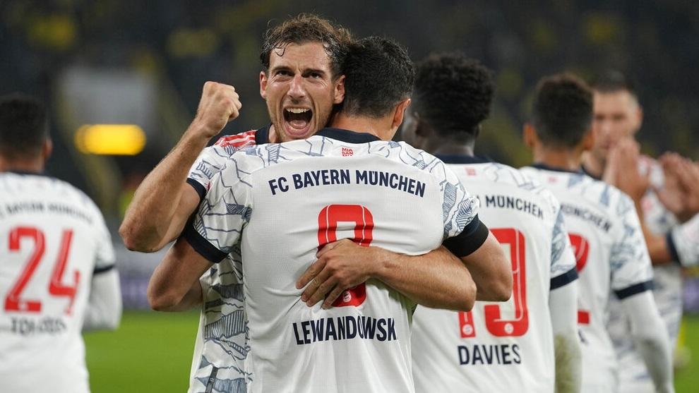 Robert Lewandowski celebrates with teammate Leon Goretzka after scoring his side's third goal during the German Supercup.