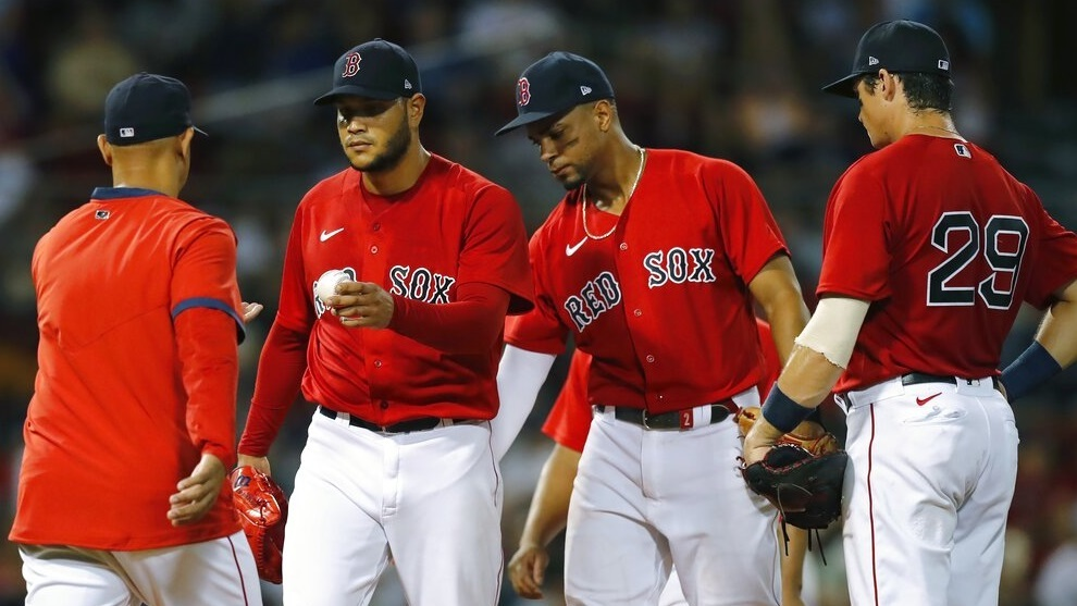 Alex Cora relieves Eduardo Rodriguez as Xander Bogaerts and Bobby Dalbec look on during the fourth inning.