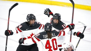 Canada's Melodie Daoust celebrates her goal with Natalie Spooner...