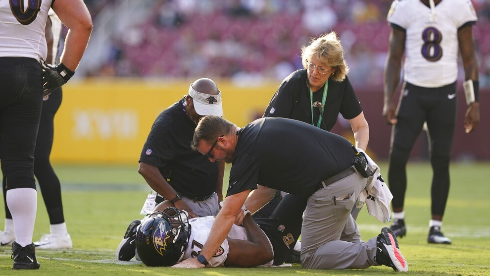 J.K. Dobbins (27) lays on the ground after suffering an injuring.