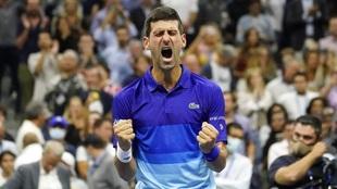 Novak Djokovic reacts after defeating Alexander Zverev during the...