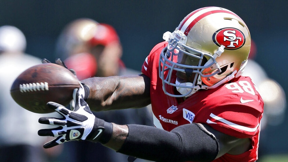 Parys Haralson reaches for the ball during NFL football training camp in Santa Clara.