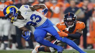 Denver Broncos' Pat Surtain II (2) tackles Los Angeles Rams'...