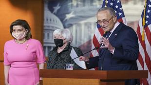 Nancy Pelosi (left), Treasury Secretary Janet Yellen (center), and...